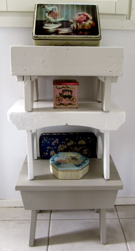 Old milking stools were given a new life in shades of gray and white.