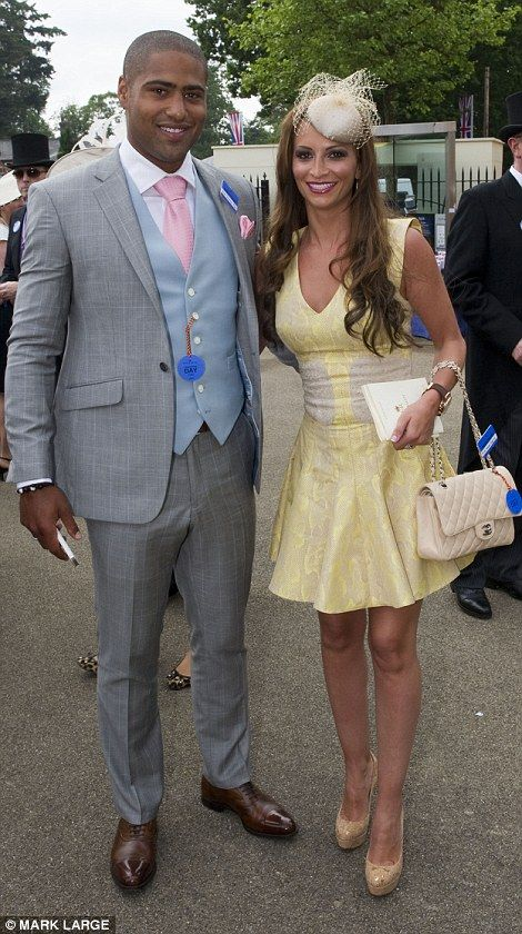Glamorous: TycoonTim Jefferies appeared ready for rain as he arrived with his wife, Malin Johansson. Glen Johnson, meanwhile, made the most of his grey suit with a pink tie