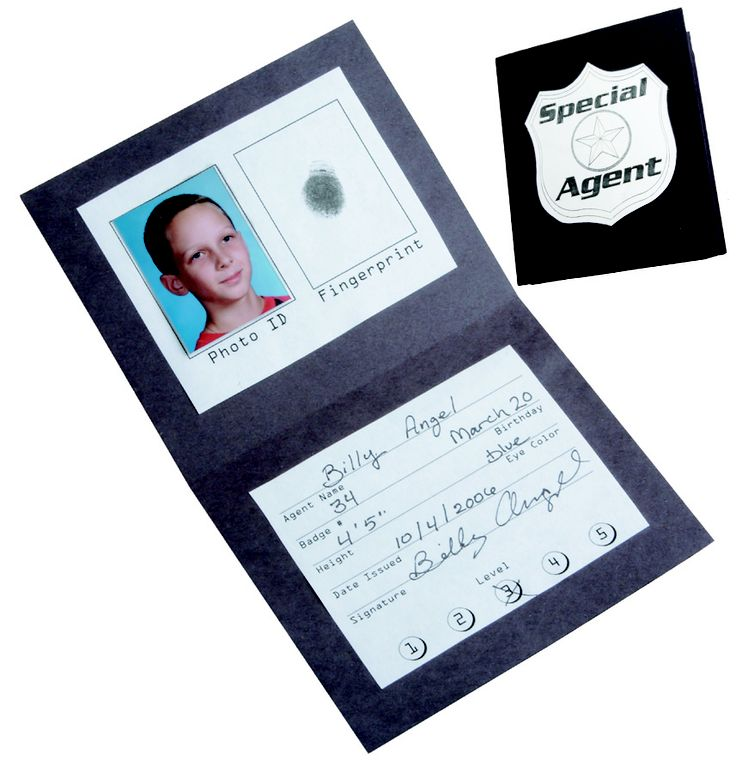 """Agent ID Badges from Guildcraft Arts & Crafts! Mission possible! These badges get little imaginations going. Includes black cardboard covers, metallic badge stickers, information cards, washable ink pads and glue sticks. 5"""" x 4 1/4""""."""
