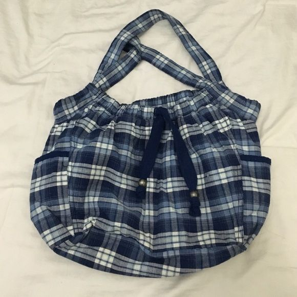 American Eagle Outfitter Tote Bag Like new, only used a couple times. Blue and white plaid bag with drawstring top and magnetic snap closure. Two pockets on the outside. One zip pocket and two other pockets on the inside. American Eagle Outfitters Bags Totes