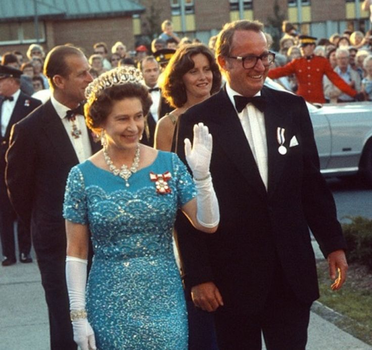 August 01, 1978 Queen Elizabeth ll waves to the public as she arrives to attend a banquet in Canada