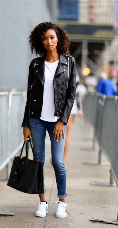 Model wearing a denim jacket, trusty jeans, and white sneakers