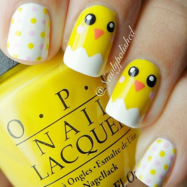 A really cute and cartoon like yellow nail art design. The design uses the combination of yellow, white, black and salmon colors to recreate cute faces and polka dots on the nails.