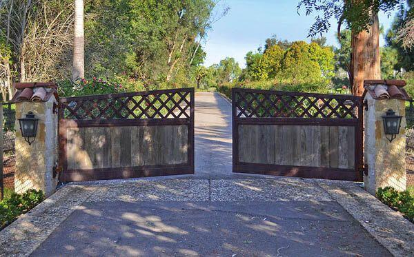 11 best custom wood garage doors images on pinterest for Driveway gates online
