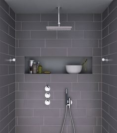 Large tiled, walk in showers- like the look of the large subway tiles.