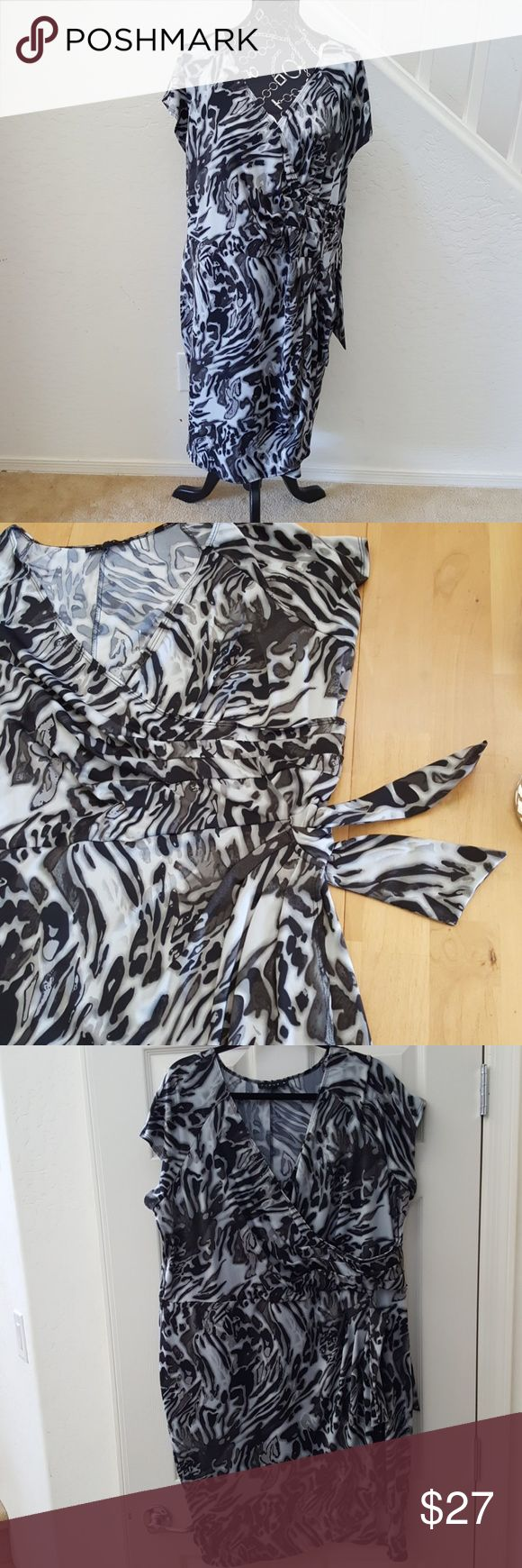 "Ruched Side Tie Animal Print Faux Wrap Dress 2x P Super stylish faux wrap dress in size 2x Petite. Length is 41"". This dress is so flexible both in fit and style. Easily go from career to ""night out"". Polyester Spandex blend has a nice weight to it to drape just right without being clingy. Side Tie adjusts fit. Machine washable. Thanks for looking! Tiana B.  Dresses"