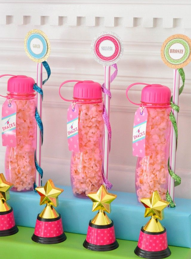 Favor ideas gymnastics sports drink bottles and filled them with popcorn and added giant pixie sticks which I turned into ribbon wands.