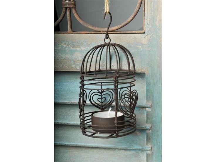 Svícen Amarone . Závěsý kovový svícen ve tvaru ptačí klece na jednu čajovou svíčku. Hnědá barva. Rozměry 7x12cm.