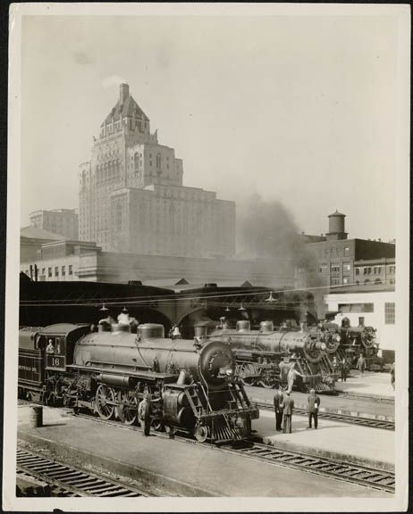 Steam engines, eastern entrance to Union Station, Toronto, with the Royal York Hotel in the background.