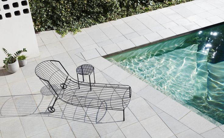 TIDAL Outdoor Furniture Collection I TIDAL Sunlounger (cushion available) & TIDAL side table designed by Trent Jansen for Tait I Made by Tait I Stainless steel powder coated black I Photography: Haydn Cattach
