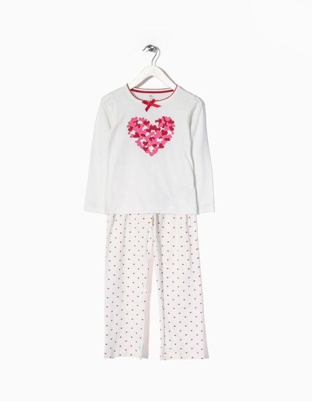Pijama de menina 100% algodão. Camisola de mangas compridas com estampado à frente e calças com cintura elástica.
