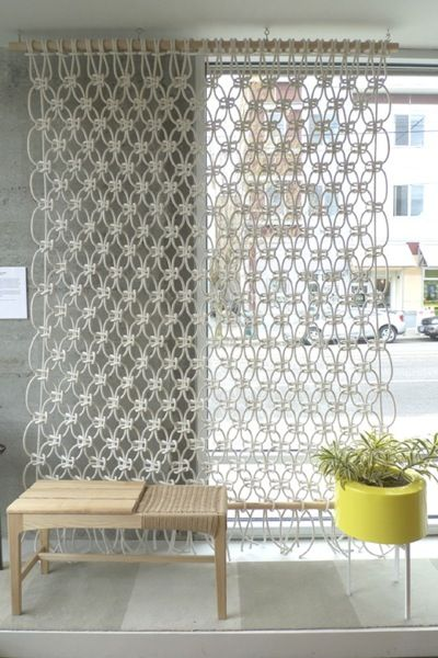 White rope Macrame room divider and/or sliding door curtain. Strung between two long, heavy dowels.