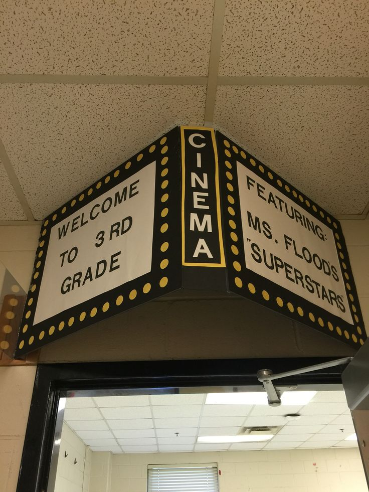Movie theater theme classroom door. Can add paper or curtain on side or on door. Cut stars to put on door with kids name on them.
