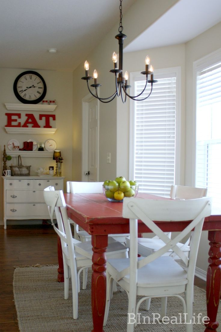 In Our Dining Room I Like Everything About This The Red Table Dresser With Floating Shelves Giant EAT Sign White Chairs