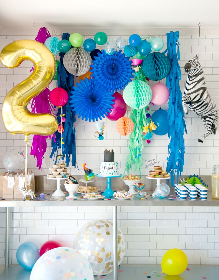 We are absolutely in love with this colourful party by Cake Ink to celebrate her son's second birthday. From the amazing backdrop to the stunning confetti cake, there are too many wonderful details in this fun set up, and the birthday boy seems to be loving it all!     Vendors: Photography: Sotiria McDonald Cake, sweets, stationery…
