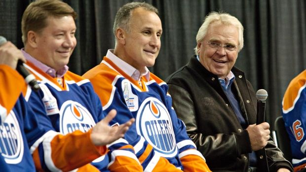 Glen Sather (right), along with Jari Kurri (left) Paul Coffey (middle), in Edmonton, Alta. in 2014. The Edmonton Oilers will raise a banner at Rexall Place to honour former coach, general manager and executive Sather.