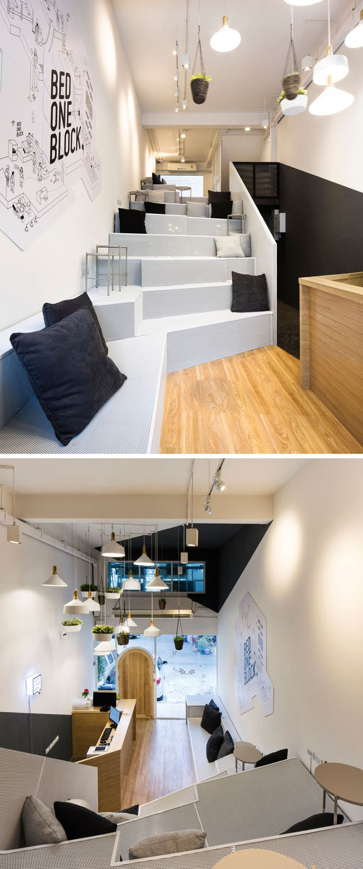 Inside is modern hostel in Bangkok, the reception desk is on the right, while bright white steps create a common area for people to meet up, work or relax.