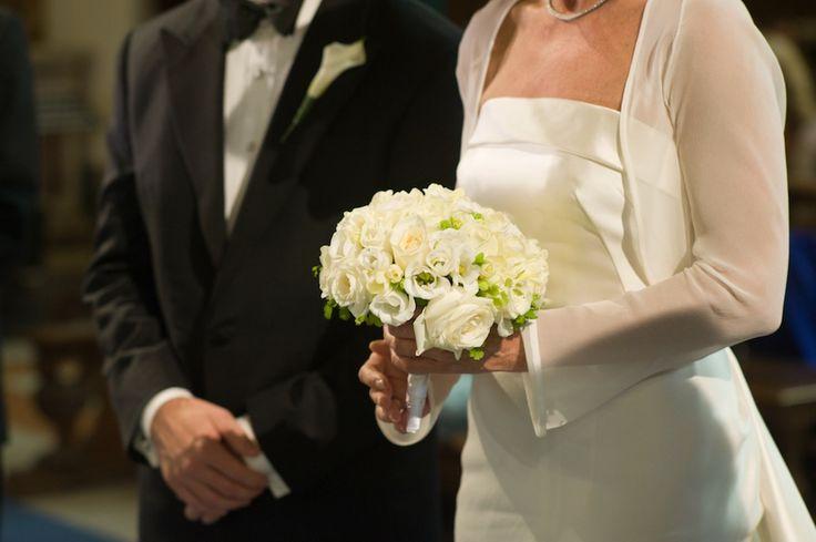 White roses, freesias and lisianthus