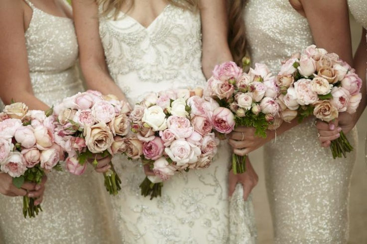 Bouquets of David Austin roses in beautiful pale pinks perfectly compliment sequin and bead detailing in the bride and bridesmaid's dresses. Flowers and styling by Victoria Whitelaw Beautiful Flowers.