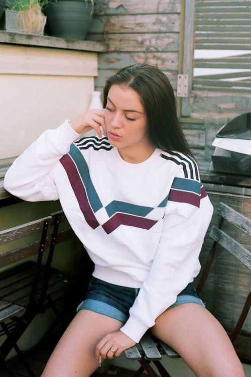 Short shorts and a long-sleeved top.  Dark-haired teen girl.