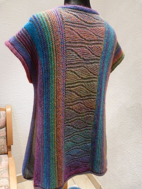 Oh MY! Looks like sideways knit in garter with different color yarns, then a garter/purl pattern at the center with a tonal variegated.