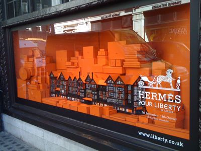 Hermes window display: Using colour...building silhoutte and window glass...for depth