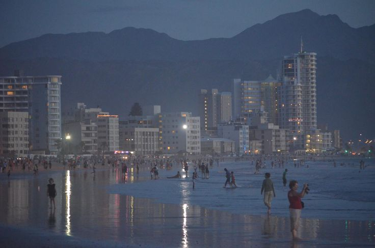 During the summertime the #Melkbaai area draws many local strollers, surfers and swimmers who enjoy Strand beach after sunset. With an average of 11 daylight hours in December and January, this is a typical scene at about 20h00 at night. #strand #strandbeach #strolling #surfing #walking #swimming #daylighthours #Strand