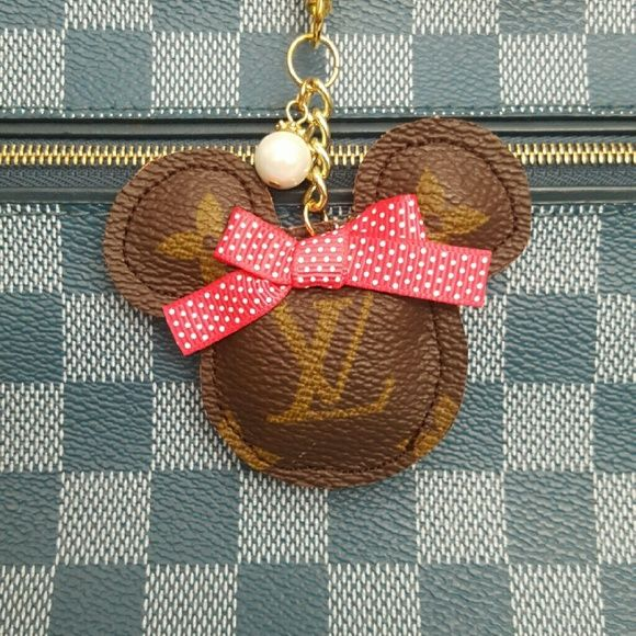 Minnie Mouse charm Handbag charm or keychain upcycled from 100% authentic Louis Vuitton canvas.  LV canvas is used on both sides so you don't have to worry about the charm flipping over.  Let me know if you need a bigger clip for your bag/keychain - I have a few sizes available.  These are handmade with LVoe :) Custom requests welcome! Louis Vuitton Accessories