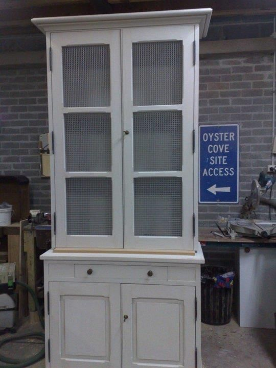 French style, kitchen cabinet, with chicken wire on the doors on top with two internal shelves,a single draw, single internal shelf in the base.  Finished with french hinges, brass knobs, hand painted in faire biance with a white wash finish.