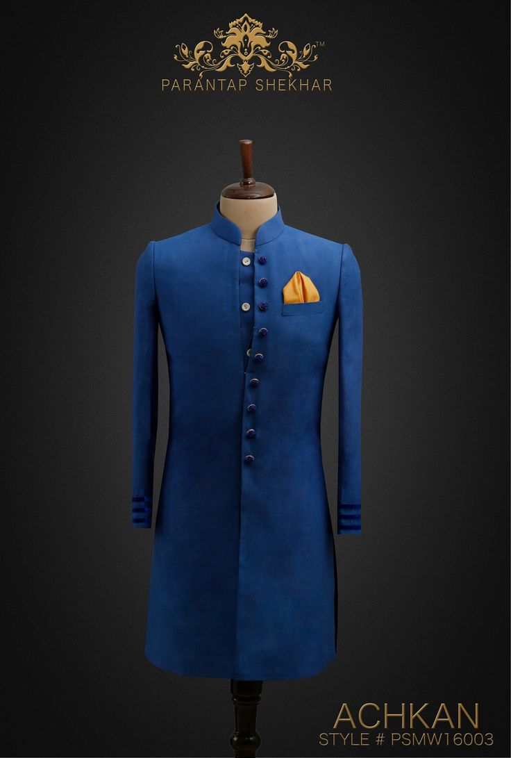MENSWEAR: Malibu Blue Royal Silk Achkan, Crystal Swarovski Metallic Buttons at Straight front Placket and Velvet Stripes at Sleeves Ends. Complete Outfit: Achkan, White Pyjama Pants & Silk Pocket Square For more info, catch us on www.parantapshekhar.com