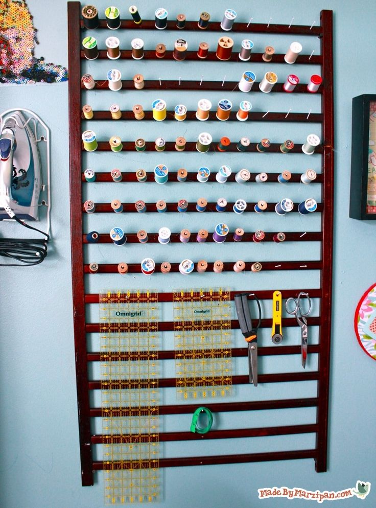 Don't throw out that old crib! Turn it into an organizing rack for your sewing or crafting supplies.