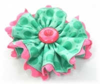 Fabric Flower with Ric Rac Trim (this site includes a ba-zillion free hair bow tutorials and single prong clips as well as other clips to purchase)