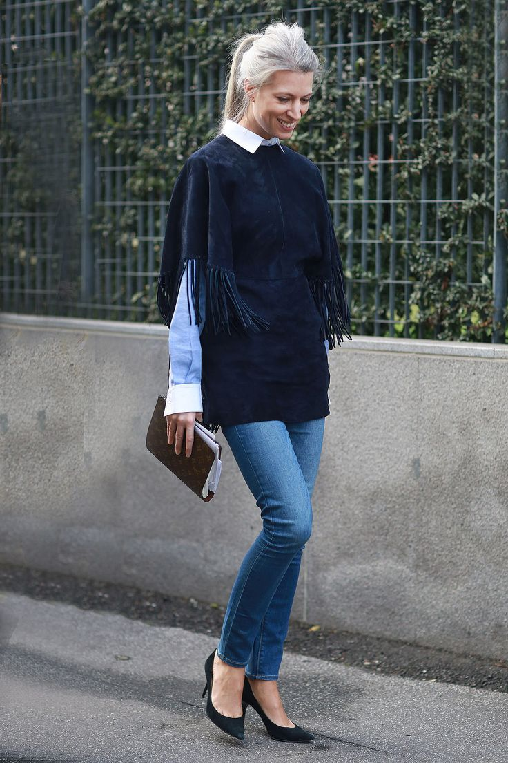 MFW Street Style Day Four: Classics are cool, but they're cooler with layers of fringe. Source: Tim Regas