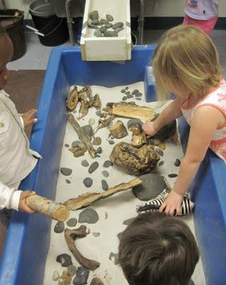 sticks and stones sensory table. This one was so meant for me! I might add fossils to mine :)