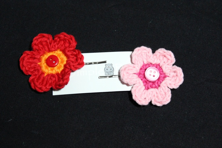 A Pair Of Beautiful Hair Grips With Crochet Flowers and Buttons By Dimplebum. $4.65, via Etsy.