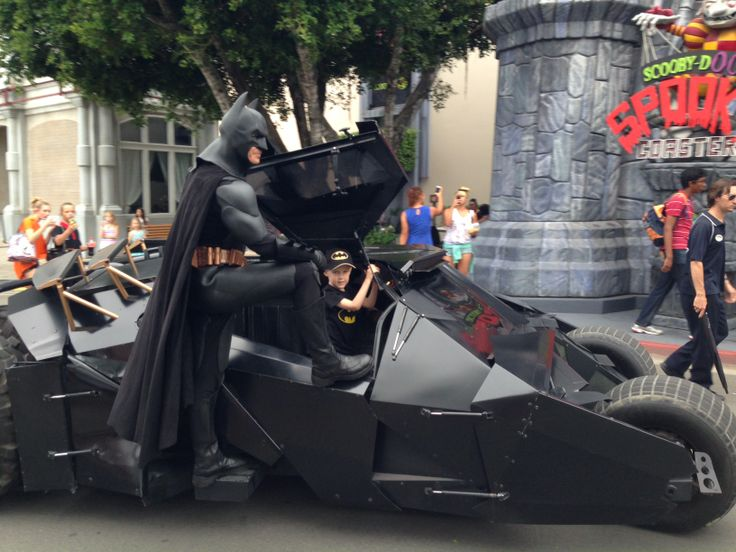 Max, aged 5 has a brain tumour. Here he is getting a personal ride with Batman at Movieworld on the Gold Coast of Australia where he went with his family for a holiday organised by Make-A-Wish