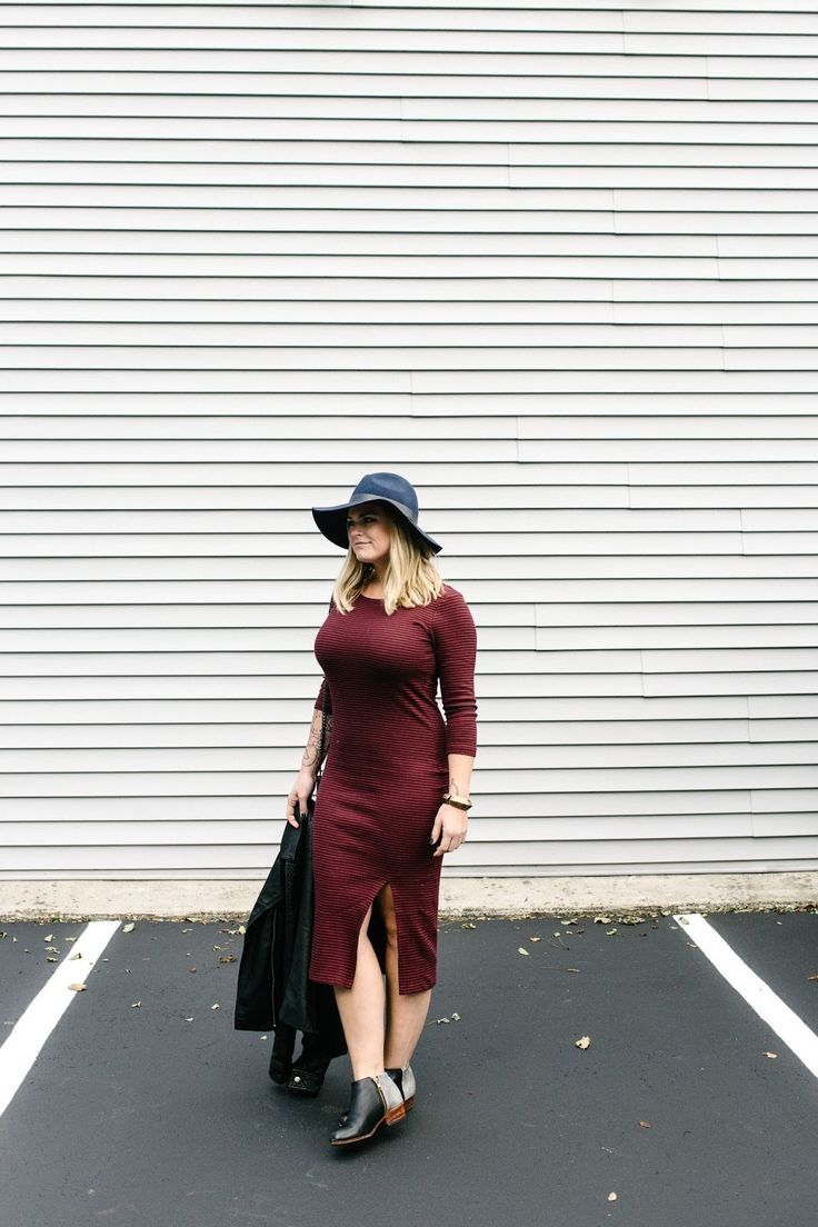 Reach for a black leather biker jacket and dark red midi dress for a casual level of dress. A cool pair of black leather booties is an easy way to upgrade your look.   Shop this look on Lookastic: https://lookastic.com/women/looks/black-biker-jacket-burgundy-midi-dress-black-ankle-boots/14572   — Navy Wool Hat  — Burgundy Midi Dress  — Black Leather Biker Jacket  — Black Leather Ankle Boots