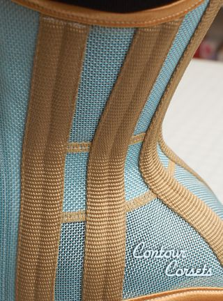 Contour Corsets summertime waist training corset in blue sky poly mesh with gold contrast.