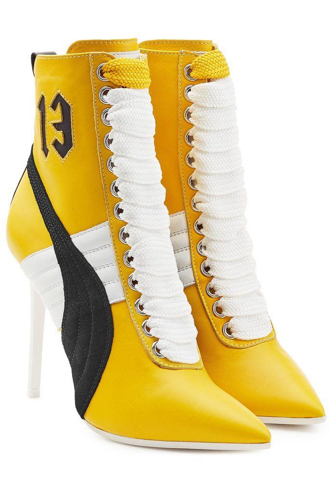 #Fenty #x #Puma by #Rihanna #Geschnürte #Heel, #Boots mit #Leder #, #Schwarz für #Damen Wie eine Mischung aus Heel und Sneaker kommen die knallgelben Boots von Fenty x Puma by Rihanna daher: die spitze Kappe und der hohe weiße Heel wirken sehr weiblich, während dicke weiße Schnürsenkel, das Zahlen > Detail und Lederbesätze in Schwarz und Weiß an die typischen Puma > Sneakers erinnern. Kurz: ein besonderer Schuh, der auffällt!