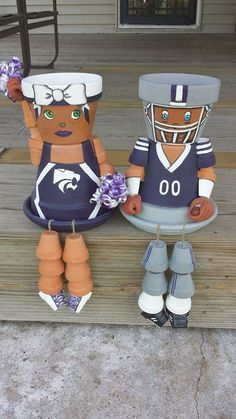Hand painted terracotta pots pieced together to make cute people. Great for Ksu Wildcat fans.