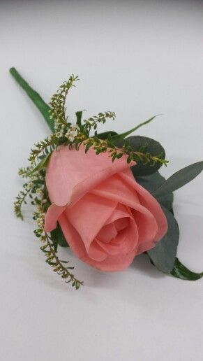 Salmon rose and thrip buttonhole