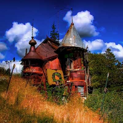 Outside Pullman, WA:  high school teacher, Victor Moore, constructed this impressive structure as his 1970 Master of Fine Arts thesis assemblage sculpture.  Constructed entirely of salvaged materials from a local junkyard and defunct rock quarry where the property is located, it only cost him 500 dollars.
