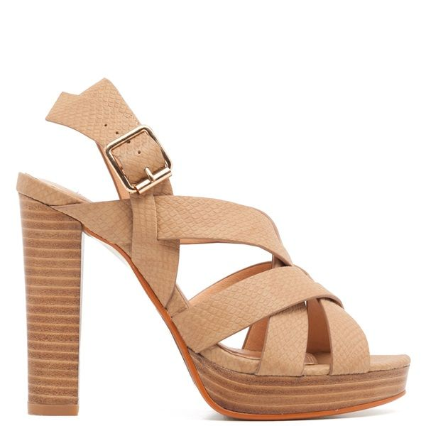 Camel high-heel sandal with cross over straps. Features wooden chunky heel and fastens with adjustable ankle strap.
