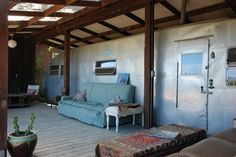 a porch on a vintage airstream-- my idea of a retirement home!