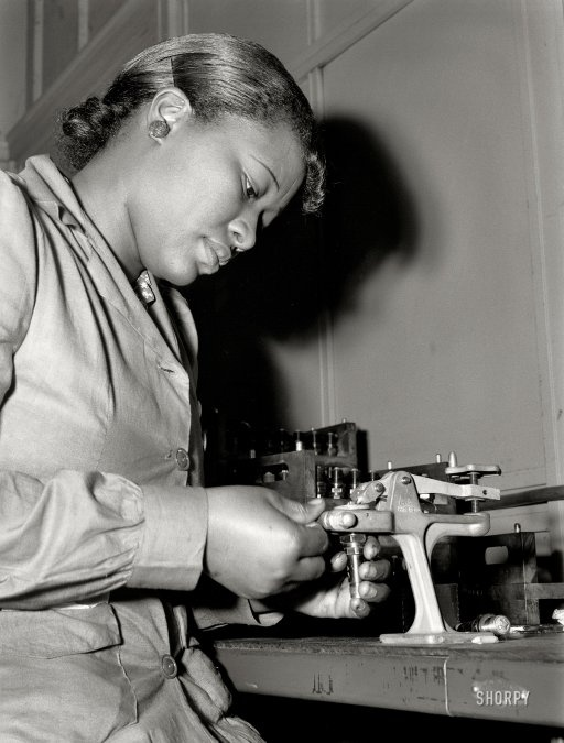 Chicago, 1942. I love this shot. Mighnon Gunn tests spark plugs for aircraft engines. A real-life Rosie the Riveter.