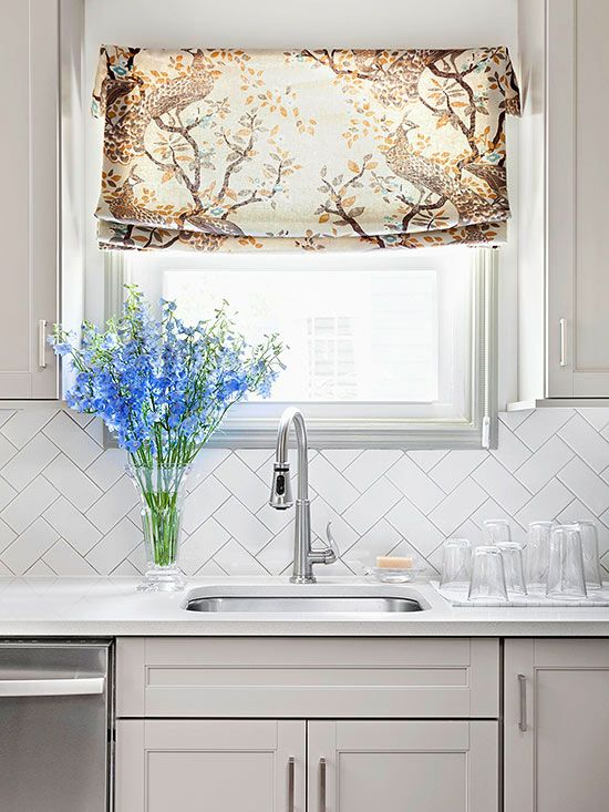 For a beautiful budget minded backsplash, install inexpensive white ceramic subway tiles in a sophisticated herringbone pattern!