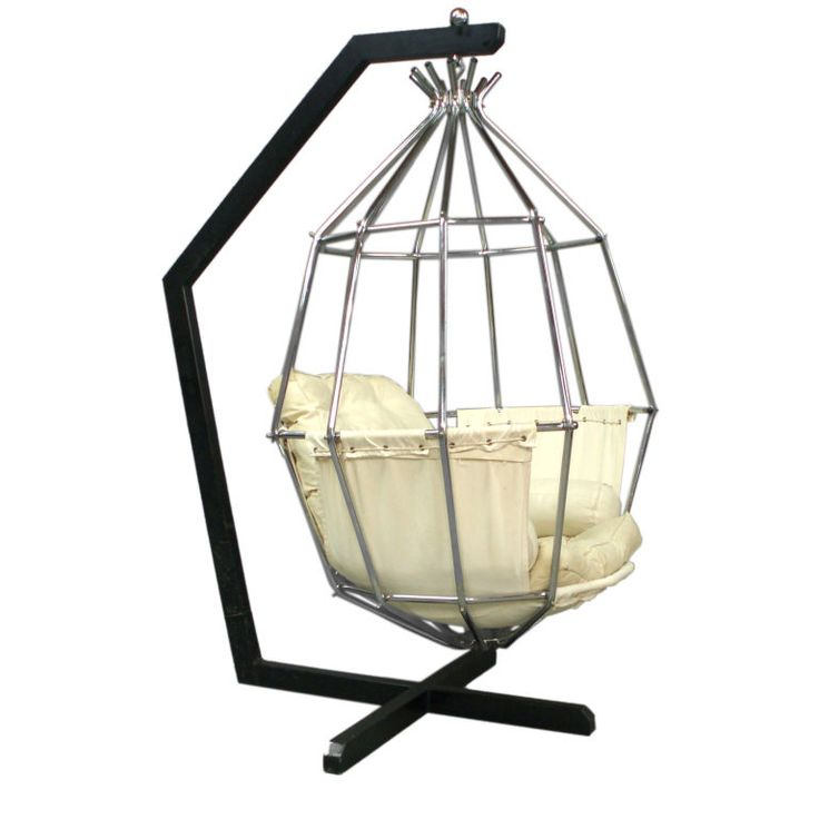 LOVE this chair - hanging parrot cage chair designed by Ib Arborg