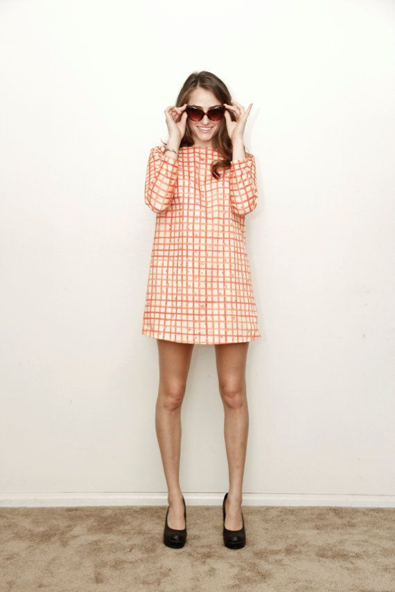 A mod dress in a cheery grid print.