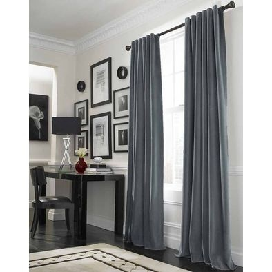 Crisp white walls with grey curtains