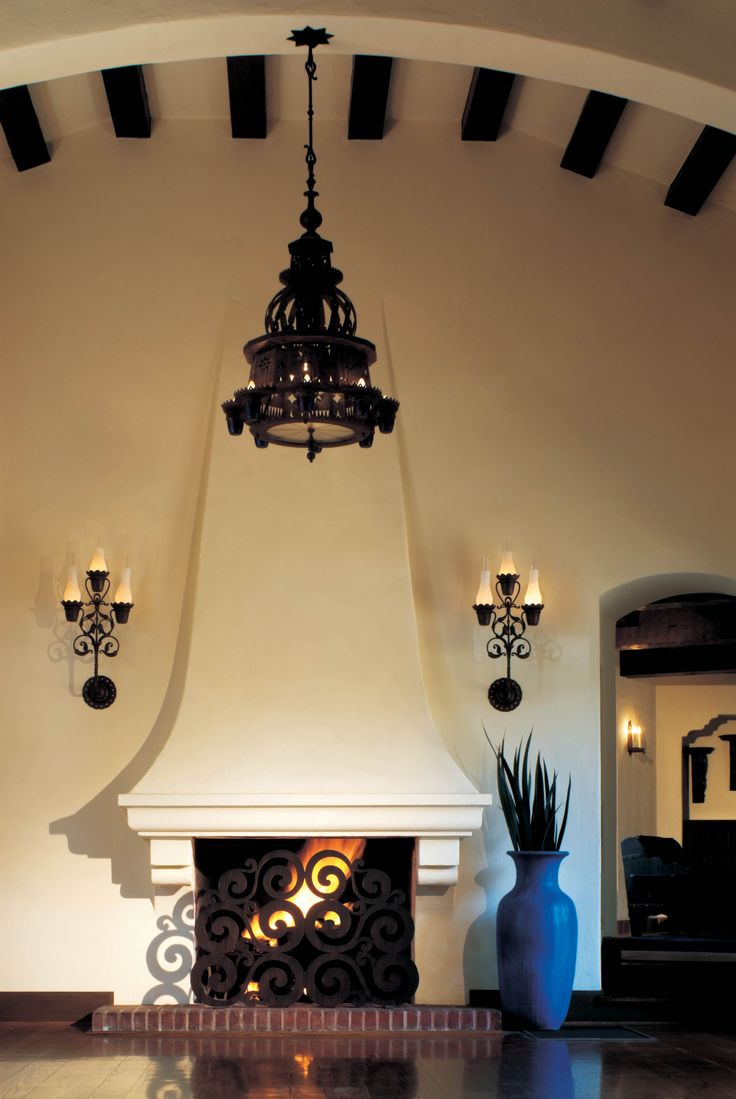 Beautiful iron details and dark beams in this Spanish style home. - Love the detail... I love Spanish style homes..